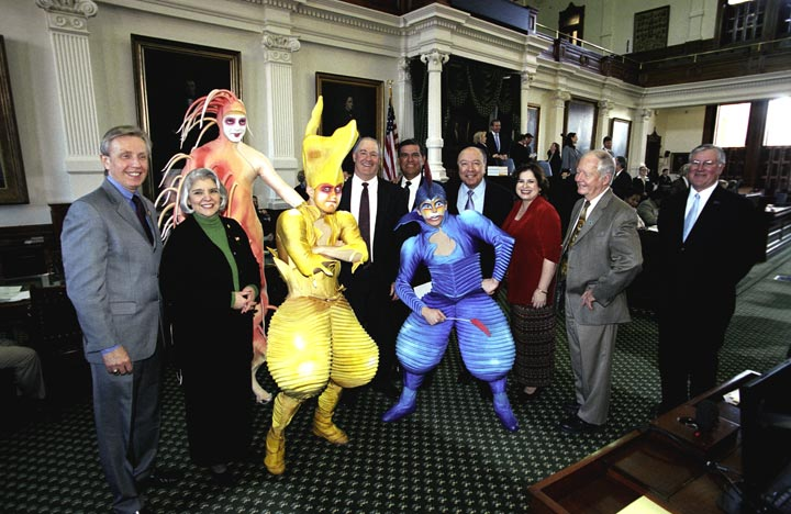 Members of the internationally famous Cirque de Soleil visited the Senate floor on the occasion of the troupe's 20th anniversary.  Pictured with the performers (l-to-r) are Senators Bob Deuell, Judith Zaffirini, Kel Seliger, Eddie Lucio, Juan (Chuy) Hinojosa, Leticia Van de Putte, Jon Lindsay, and Ken Armbrister