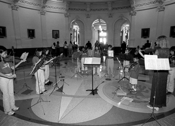 Student violinists from Mark Twain Elementary School perform in the Capitol rotunda