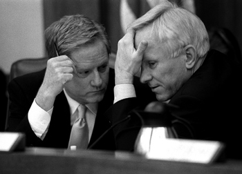 Representative Jim Pitts (left) and Senator Steve Ogden ponder the intricacies of the budget for the State of Texas