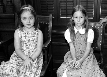 Young ladies from Cleburne sit quietly during a resolution presented by Senator Averitt